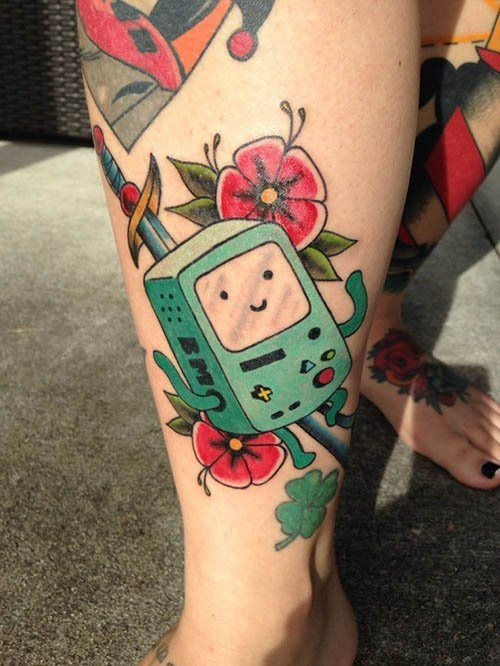 BMO! Is there anything this little fella can't do? #InkedMagazine #BMO #tattoo #tattoos #Inked #ink #AdventureTime