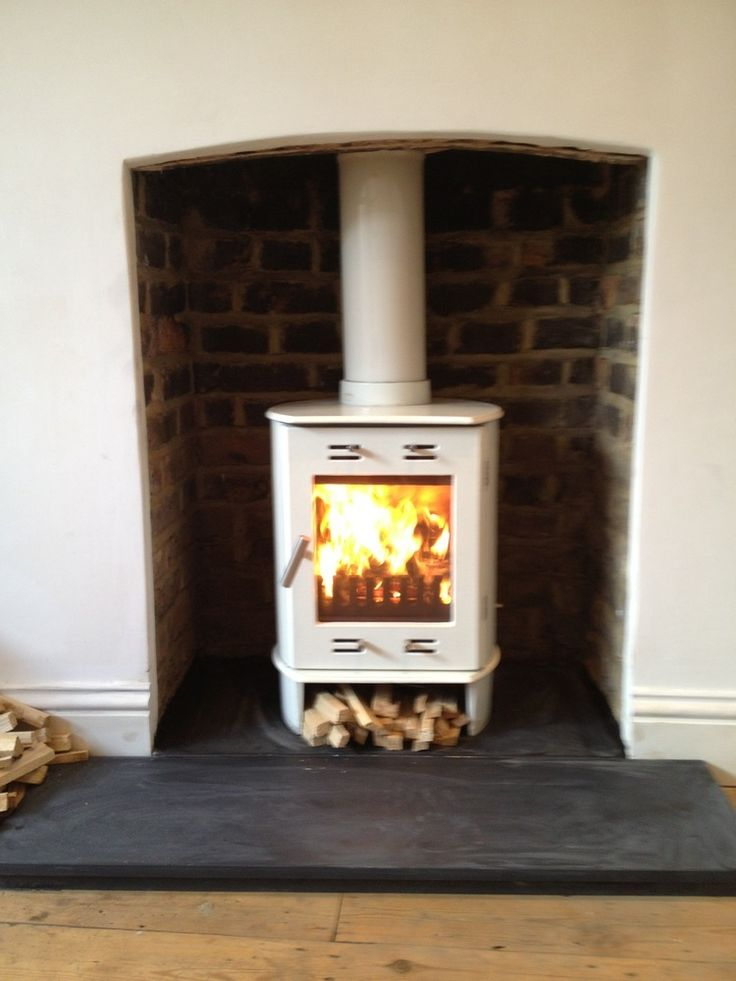 Carron Multi-fuel Stove, cream enamel and re-worked opening in Herne Hill