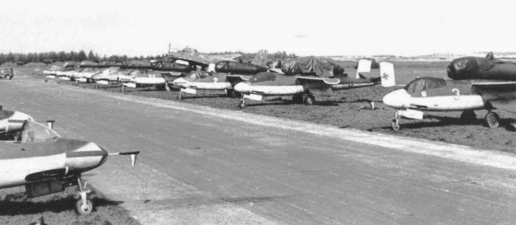 Line up of Heinkel He 162 Volksjager (People's Fighter) aircraft at Leck during the surrender, WWII. There were 120 He 162s at the time of Germany's surrender during WWI.  Read more: http://worldwartwo.filminspector.com/2014/12/he-162-salamander.html#ixzz44Fei7icm  Under Creative Commons License: Attribution  Follow us: @jamesjbjorkman on Twitter