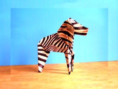 Origami Zebra - Uploaded on Oct 9, 2007 Folding an origami zebra. Intro-music from: www.freeplaymusic.com. More origami on http://www.joostlangeveldorigami.nl/ I have a printable origami zebra paper here: http://www.joostlangeveldorigami.nl/p...