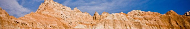 Badlands formations against the blue sky; photo by Rikk Flohr Badlands 75 miles east of rapid cirty