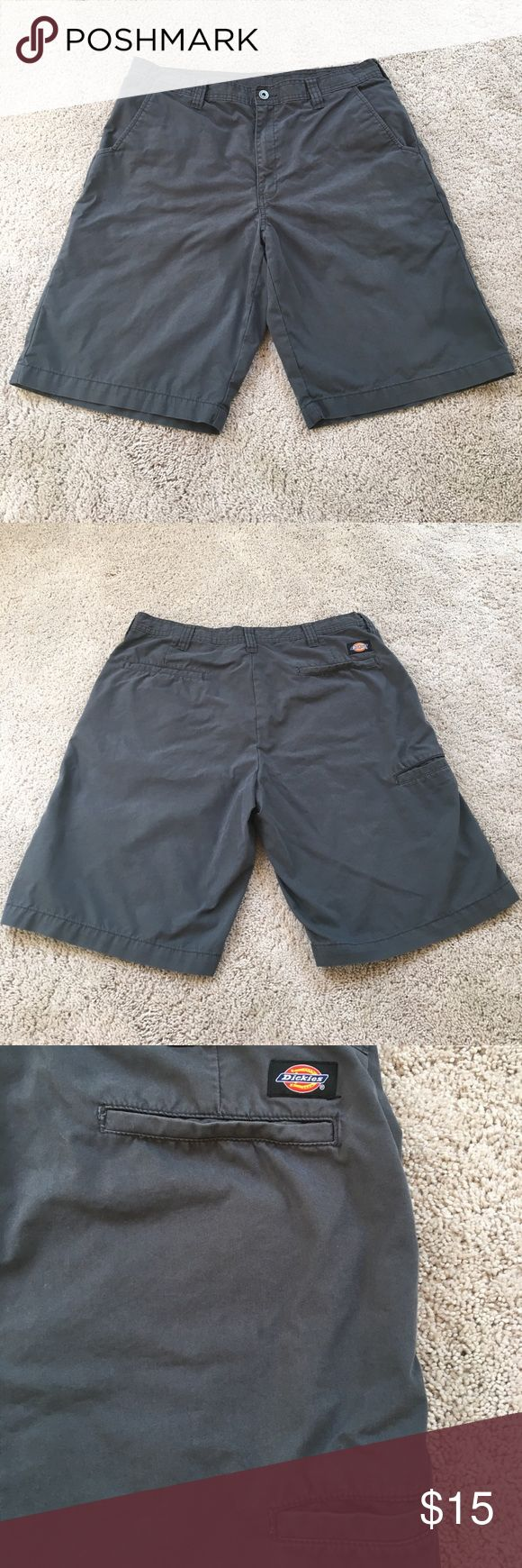 """Dickies dark gray shorts 34 waist 10"""" inseam Dickies dark gray shorts 34 waist 11"""" inseam. Phone pocket on right side, Velcro closures on back pockets. In great shape. 70% cotton 30% nylon. Dickies Shorts Flat Front"""