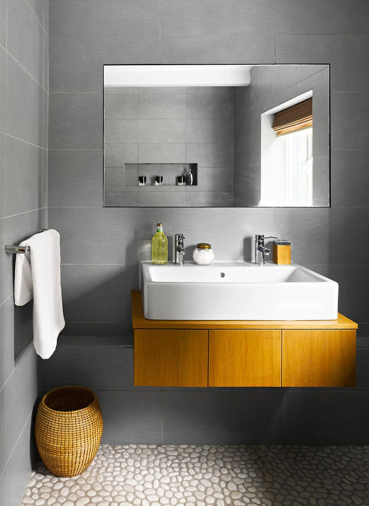 In the London Suburbs, a Home Rebuilt Around a View White pebble floor - floating vanity modern bathroom