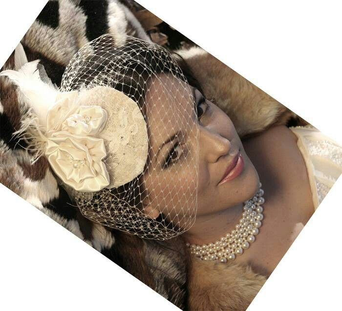 Silk swirl rosettes on a sparkly lace base with 9inch birdcage veil. By www.margotarderndesigns.com. Makeup: Sei Bella Beauty Therapy.