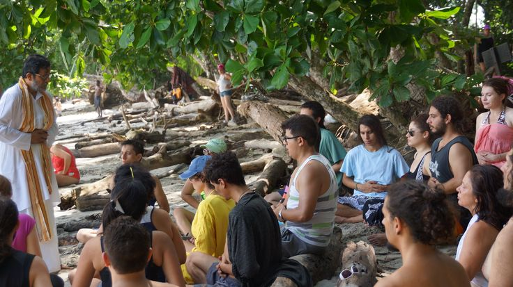 Learning breathing exercises on the Pacific Ocean Beach in Costa Rica 2014