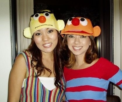 Bert and Ernie Costume. We bought trucker hats from a thrift store and covered them with felt. We used foam balls for the eyes. We also found clothes from the thrift store and cut them up.