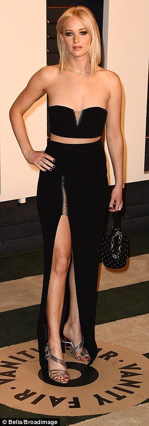 Co-ordinates: Jennifer Lawrence looks lovely in a matching black bandeau with lace up detail & long black skirt featuring a thigh split #afterparty...x
