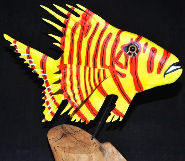 """Spiny Clown, carved from Sequoia, it about 18"""" long, 24"""" high on its maple base, painted with acrylic paint"""