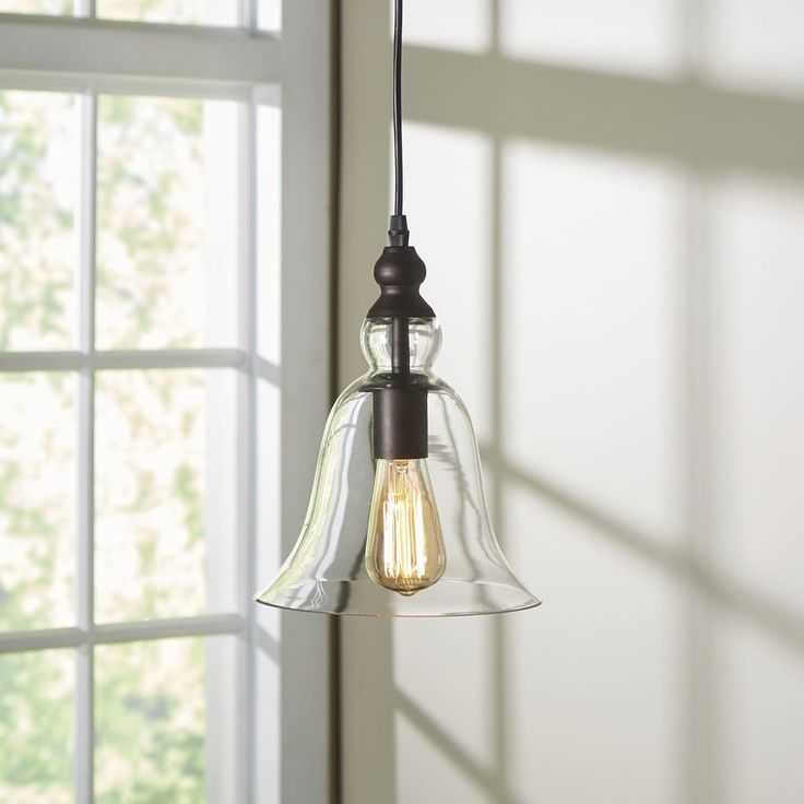 Mixing Finishes With Clic Looks The Antioch Mini Pendant Features A Clear Gl Shade Crafted