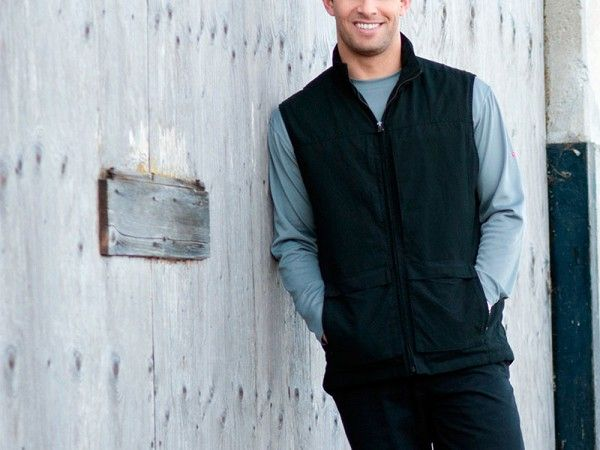 Men's Travel Vest by ScotteVest. Has 42 pockets!! These include one with RFID blackout lining; compartments for up to two iPads; and a large exterior back panel (like a small backpack). Also comes with something they call a Personal Area Network, essentially a built-in system for charging electronics.