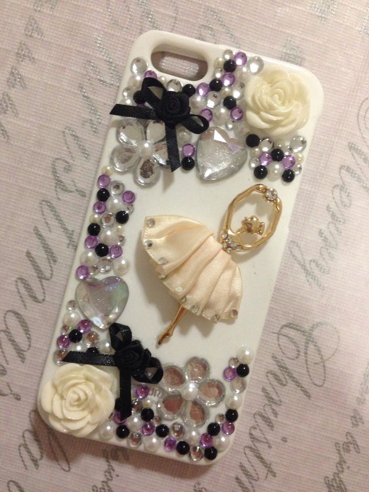 DIY iPhone 5 case, made with rhinestones, bows, a ballerina pendant, craft glue and modge podge to seal it.