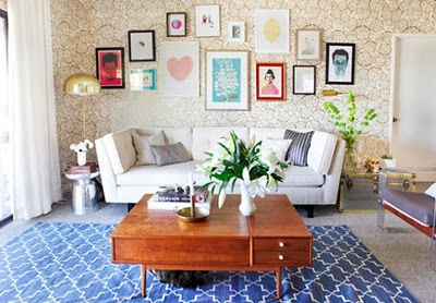 Picture frame arrangement, coffee table, sofa, wallpaper