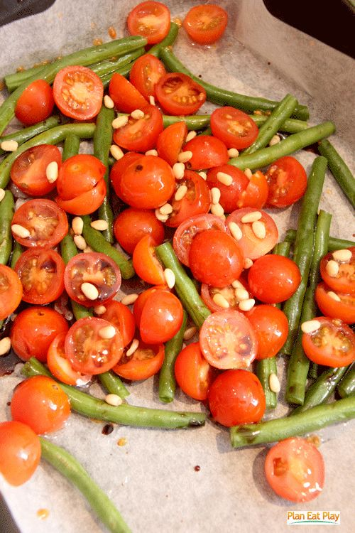 Easy baked vegetables - A few tomatoes, beans, pine nuts and a drizzle of olive oil. http://www.planeatplay.com/12-ways-to-wrap-up-the-year-day-6-3-ways-food-dress-wrap/ #vegetables #planeatplay