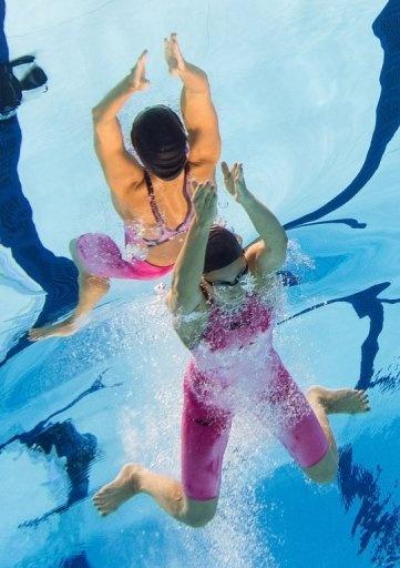 US swimmer Rebecca Soni competes to win gold and break the world record