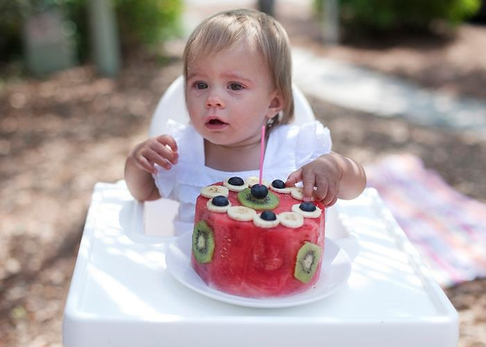 Alternative Smash Cake idea - watermelon with fruit decorations. Sort of ruins the fun... except my baby loooooves watermelon and kiwi... and I'm obsessed with keeping him from processed sugar...