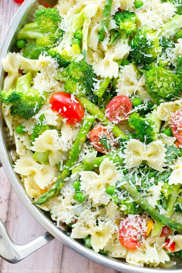 Loaded with a rainbow of springtime vegetables and lots of Parmesan, this garden-fresh pasta primavera is a delicious and healthy Spring side dish!!