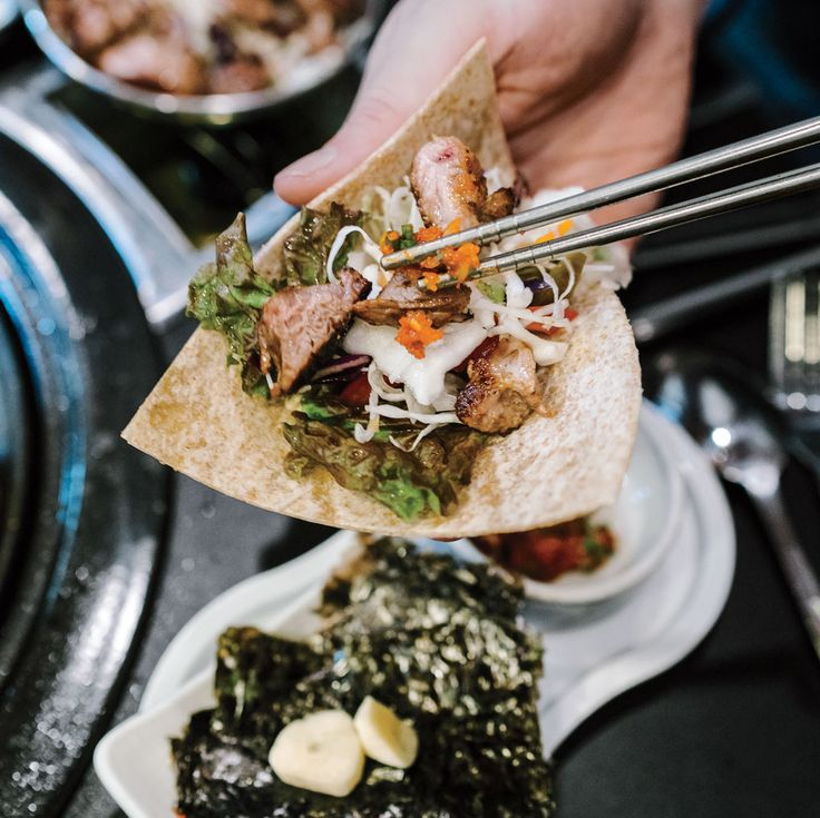 Ashlea Halpern spent two weeks eating her way through this fast and furious—and food-obsessed—city of 10 million to discover bulgogi cheesesteak, owl cafés, and other trendy (and traditional) surprises.