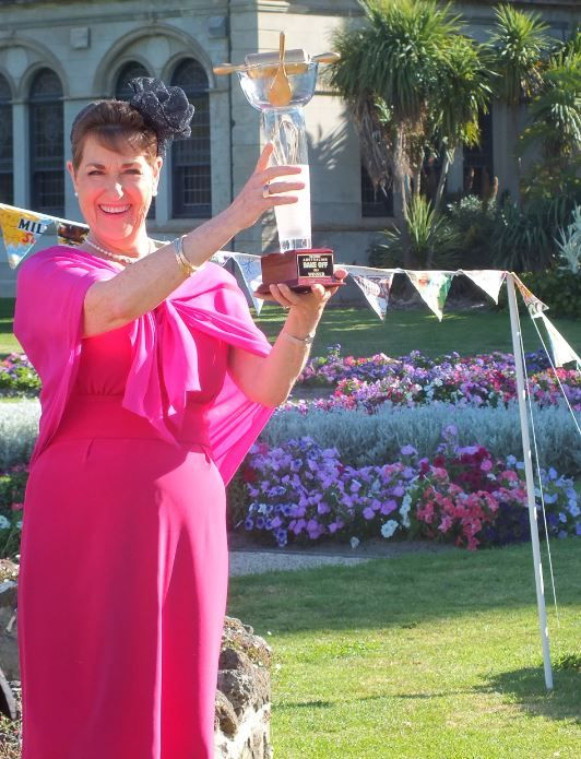 Kerry holds high the coveted Bake Off trophy!