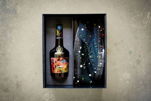 A customized bottle of Hennessy to come packaged along with a nice pair of dope sneakers...I'd take it