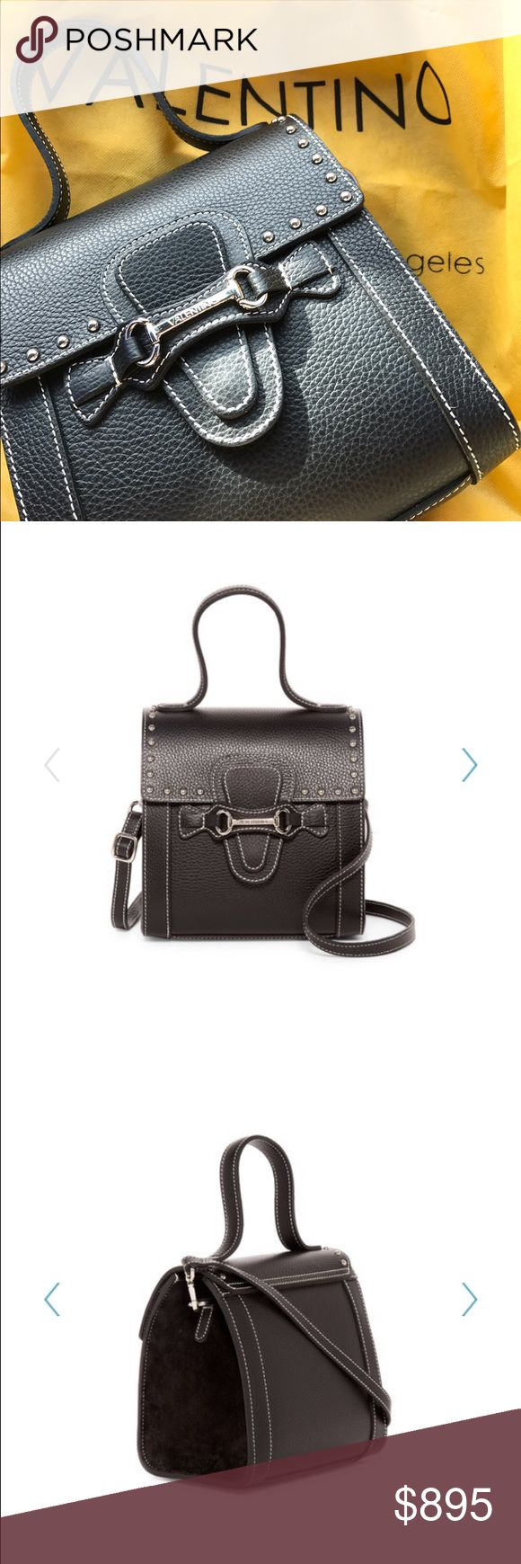 """SALE  Valentino  Agnese bag - Single top handle - Detachable, adjustable crossbody strap  - Foldover top with slip lock snap button closure - Exterior features leather construction with suede panels, logo embossed metal bit, and studded detail  - Interior features 1 wall zip pocket - Dust bag included  - Approx. 8"""" H x 7.5"""" W x 4.5"""" D - Approx. 5"""" handle drop, 13-24"""" strap drop - Made in Italy Valentino Bags Mini Bags"""