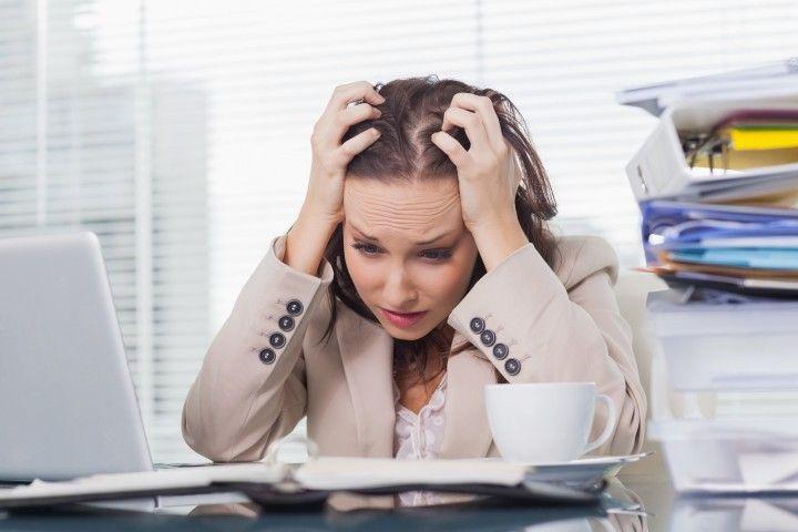 bigstock-Nervous-businesswoman-pulling--49607888