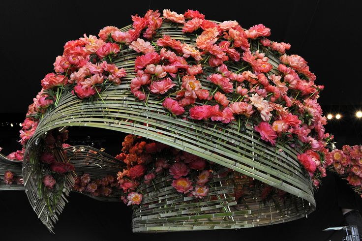 Daniël Ost (1955), floral designer. Daniel Ost is an artist who works with flowers, plants & trees. His floral art was first recognised in Japan where floral decoration has long been recognised...