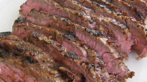 Beef skirt steak is an inexpensive cut that turns into a gourmet treat when marinated in a cola and coffee-based mixture and grilled.