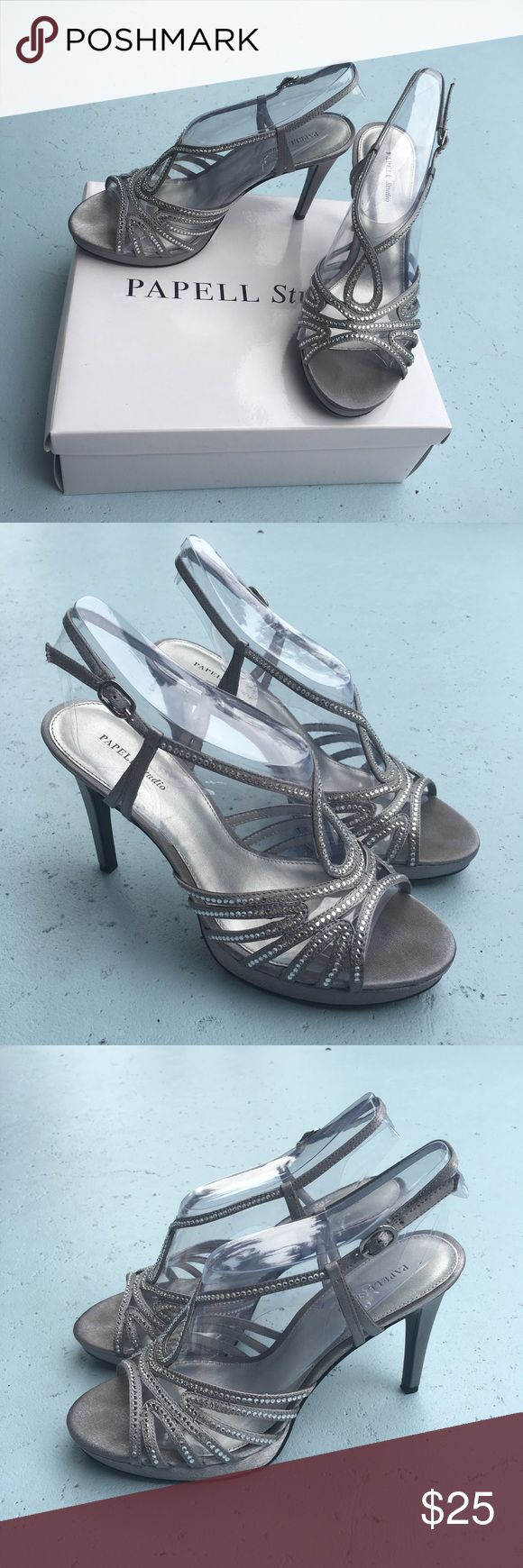 Silver heels Silver Papell heels. Worn once for prom, perfect for prom or formals. Very easy to walk in and comfortable, heel is 3 inches. Size 8.5 but I'm normally an 8 and these fit perfectly Papell Boutique Shoes Heels