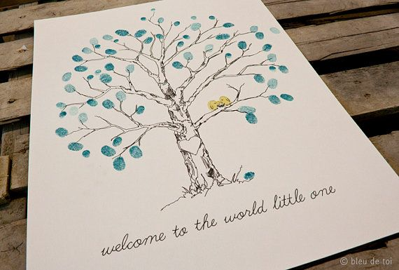 The sweetest baby shower guest book you ever did see!  I ended up doing this for my son's baby shower.  Luckily my dad is an artist (as I am not) and he drew me a pretty cool tree.  It now hangs in my baby boys nursery!  A nice reminder of all the people who love and support him! I love it!