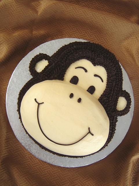 Middle child's birthday cake this year? monkey cake by springlakecake, via Flickr