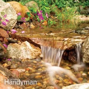 Build a Backyard Waterfall and Stream that flows into a gravel bed, not a pond, so it stays clean with little maintenance