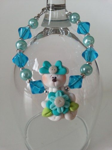 Here is an unique gift for little girl. ( 3 years old and over ) A bracelet made with a cute fimo bear and glass beads. Lengh : 6 inches  ************ My jewelry are  made to be as secure and safe as