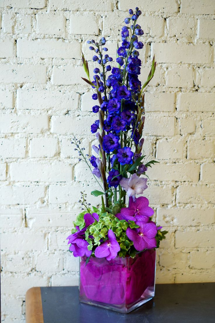 A vibrant reception vase featuring delphiniums gladioli for Flower arrangements with delphinium