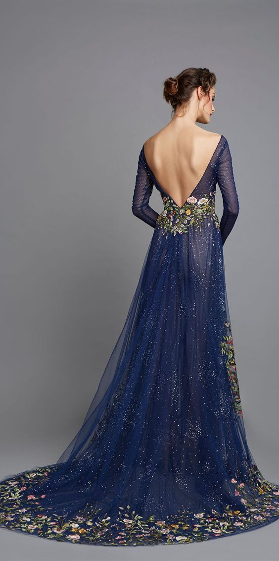 Featured Dress: Hamda Al Fahim; Long-sleeve dark blue floral printed wedding dress.
