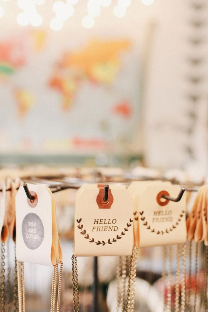 """Tags for necklace display: A way to have them out to touch, yet be """"packaged"""". Why didn't I think of this?"""