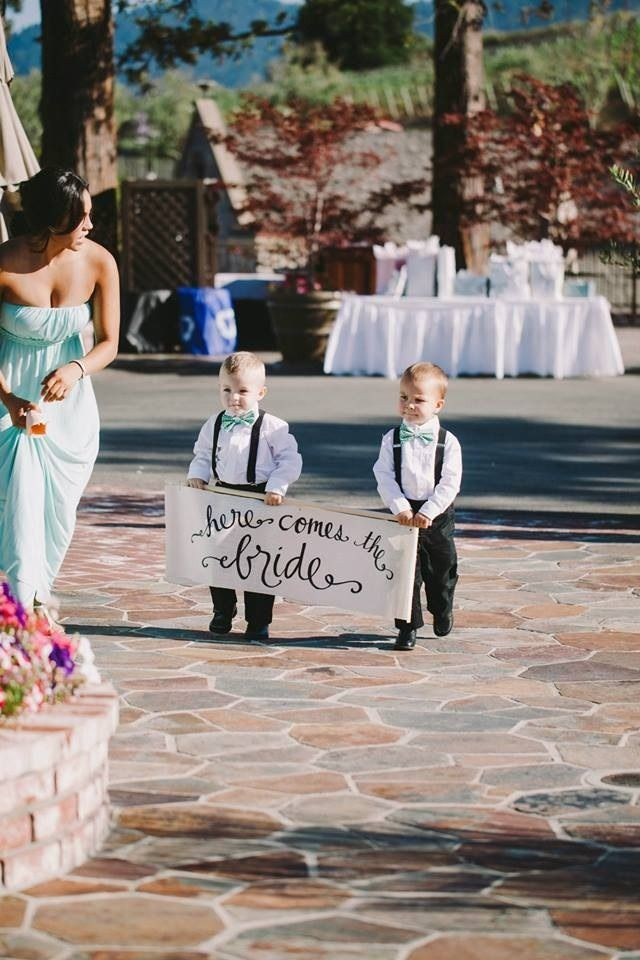 "In lieu of ring bearers, carry ""here comes the bride"" sign on burlap and wood bar.  Photography: Amie Soares"