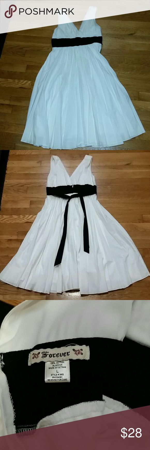 Grecian style tea dress. This beautiful white dress is perfect for an English High Tea.    Thick straps create a tasteful v neck in the front and the back.  The black empire waist can be adjusted to fit your individual size. The skirt is flowing and comes below the knee. Forever 21 Dresses Midi