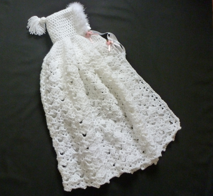 Crochet cape with maribu feather trim around the edge of hood