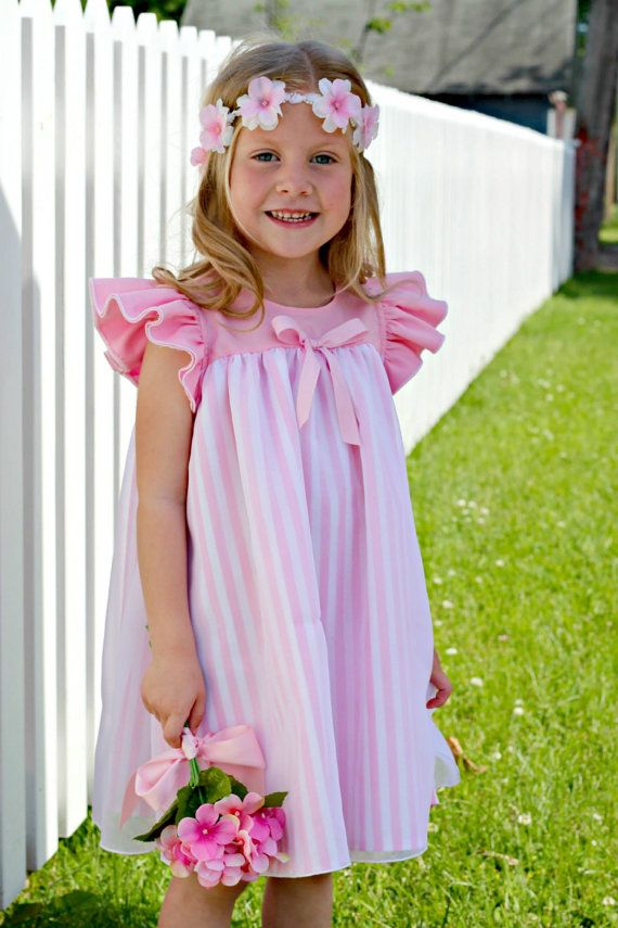 The Angel Dress is a gorgeous vintage inspired baby doll dress with a floaty sheer overlay and pretty flutter sleeves. This dress is a quick sew and suitable for all sewing levels. Sizes 9-12m up to girls size 6 This pattern is copyright protected 2015 Gracie May Designs All Rights Reserved. Please do not alter, share, sell, reproduce or resell this pattern. You may sell garments made using this pattern.