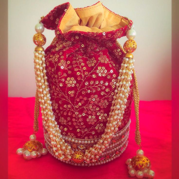Maroon Potli bag with golden pearls string and thread work- perfect for indian weddings