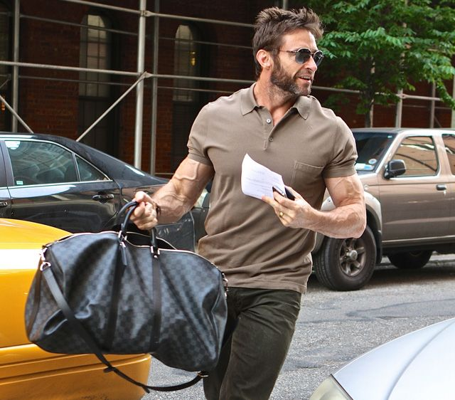 Hugh Jackman tossing his Louis Vuitton Damier Graphite Keepall Bandouliere 55 Bag into a taxi in NYC