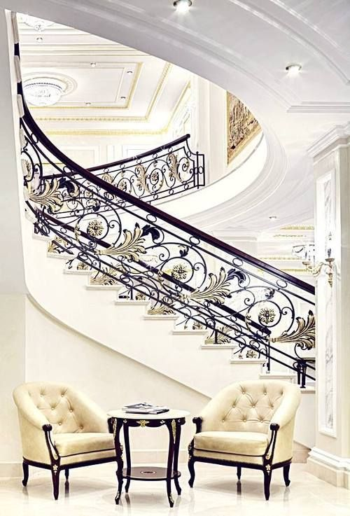 Wow, an amazing staircase dreamy out of a movie, practical no really.  However, the chairs and table will make your home look and feel like a million.  Classic elegance-the chairs will be in my new home!