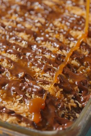 Samoa Poke Cake - A chocolate cake infused with caramel? Quit playin' with our heart!