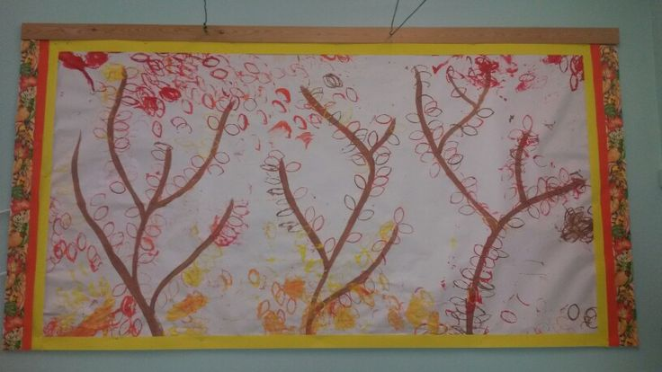 Autumn leaves made with squashed toilet rolls. Simple printing!