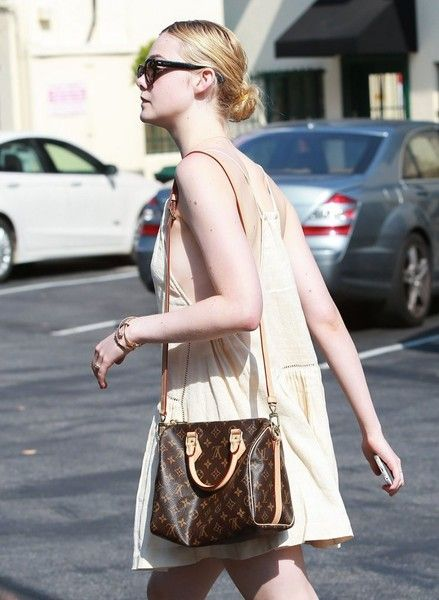 """Elle Fanning Photos - Actress Elle Fanning and her mother spotted out for lunch at Cafe Med in West Hollywood, California on August 19, 2015. A trailer for Elle's highly anticipated new film """"About Ray"""" recently debuted. - Elle Fanning Out For Lunch at Cafe Med"""