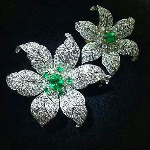 Beautifullness from @thavorn_gallery Two Colombian Emeralds and diamond flower brooches.