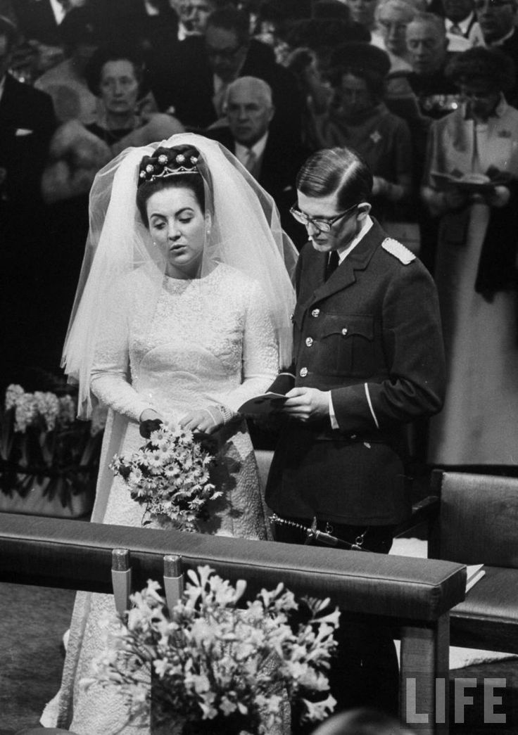 Dutch Princess Magriet wearing embroidered dress with marguerites (daisies ) during her marriage to Pieter Van Vollenhoven. 1967.