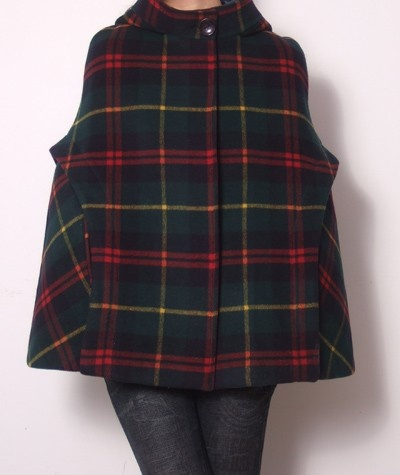 Wool Hoodie Cape Poncho.  Custom made.  Choose your color, additional lining, etc - they do it all.  I'd purchase their cashmere arm warmers, too.