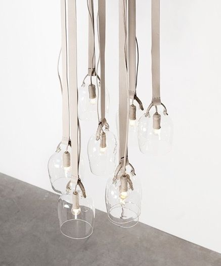 These cloches are suspended from the ceiling by ribbons