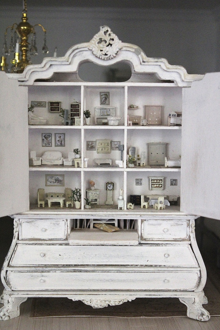 A 1:12 cabinet filled with 1:144 furniture shows a serious commitment to shabby chic. Cabinet is likely Bespaq, but you could do this in a $1 Michael's hutch.